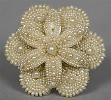 A Victorian seed pearl mounted mother-of-pearl brooch Formed as a flowerhea