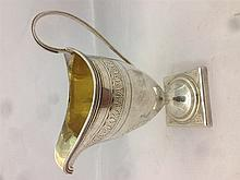 A George III silver cream jug, hallmarked London 1799, maker's mark of (?)B
