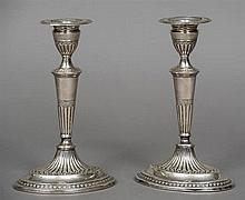 A pair of Victorian silver candlesticks, hallmarked London 1884, maker's ma