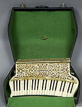 A Hohner Organetta III accordion Of typical form with mottled white casing,