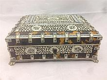 A 19th century Anglo-Indian bone mounted tortoiseshell casket The mounted p
