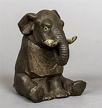 A late 19th/early 20th century novelty inkwell Formed as an elephant wearin