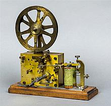 A 19th century twin coil electric and clockwork ticker tape machine, stampe