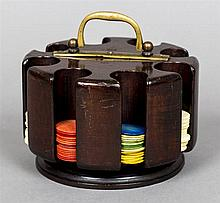An early 20th century mahogany gaming chip holder Of revolving cylindrical