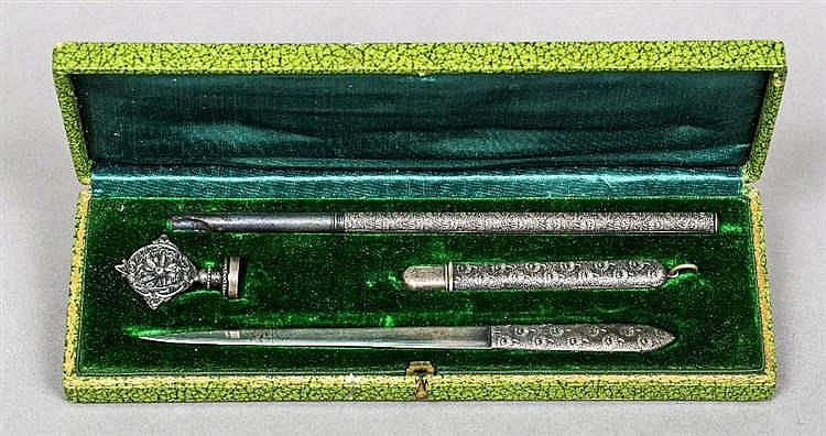 An early 20th century cased unmarked white metal desk set Comprising: a pen