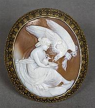 A 19th century unmarked gold mounted cameo brooch Carved with a classical m