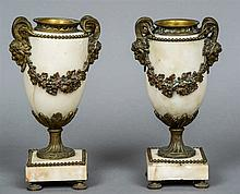 A pair of 19th century gilt metal mounted alabaster urns The handles worked
