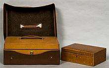 A leather case by J G Vickery, London With Bramah lock, carrying handle and