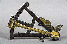 A 19th century brass mounted ebony octant Of typical form; together with a