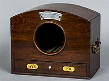A 19th century mahogany ballot box Of domed form, with central recess above