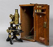 A J Swift & Son Research Microscope In mahogany case, the three lenses by R