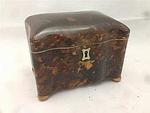 A 19th century tortoiseshell tea caddy Of small proportions, the hinged sha
