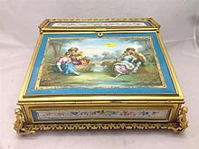 A 19th century ormolu mounted porcelain inset writing slope Inset with Sevr