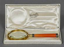 An early 20th century French unmarked white metal mounted magnifying glass