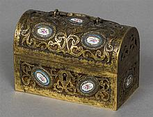 A 19th century French gilt bronze casket Of pierced scrolling hinged domed
