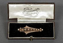 A French 18 ct gold diamond and seed pearl set brooch Of pierced slender fa