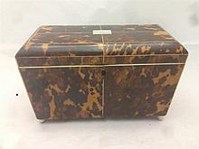 A 19th century tortoiseshell tea caddy The domed hinged rectangular top inc