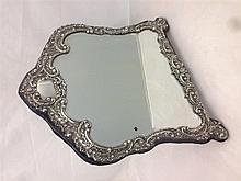 An Edwardian silver mounted dressing table mirror, hallmarked Birmingham 19