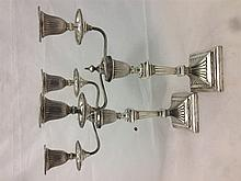 A pair of Victorian silver twin branch candelabra, the bases hallmarked She