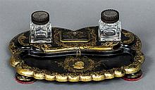 A 19th century papier mache inkstand Mounted with two carved hardwood toppe