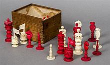 An early 19th century Chinese Export carved ivory and stained ivory chess s