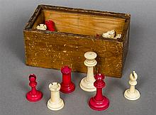An early 20th century ivory and stained ivory Staunton pattern chess set Th
