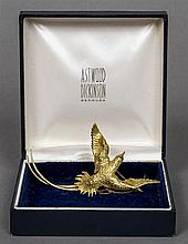 A boxed Astwood Dickinson 18 ct gold brooch Formed as a bird of paradise.