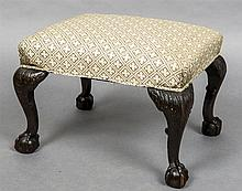 A 19th century stool The overstuffed top, standing on four carved cabriole