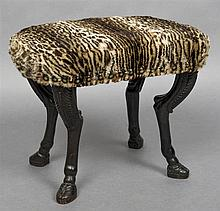 An 18th/19th century carved oak foot stool The leopard fur upholstered top