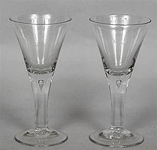 A pair of teardrop stem wine glasses  With conical bowl and spreading foot.
