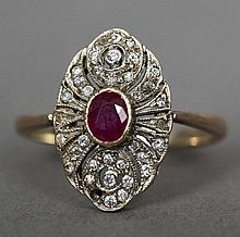 A 9 ct gold diamond and ruby ring Of pierced navette form.  1.75 cm high.