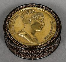 A 19th century Continental gilt decorated tortoiseshell snuff box Of circul