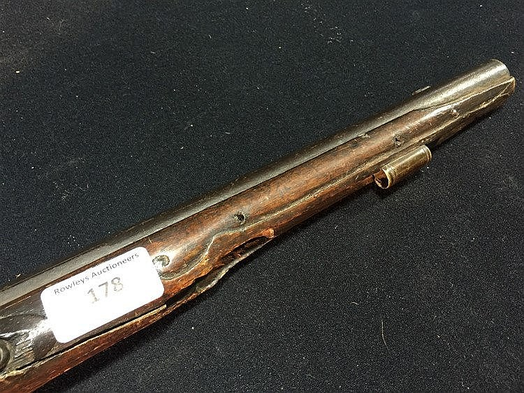 An 18th/19th century flintlock pistol The long barrel with