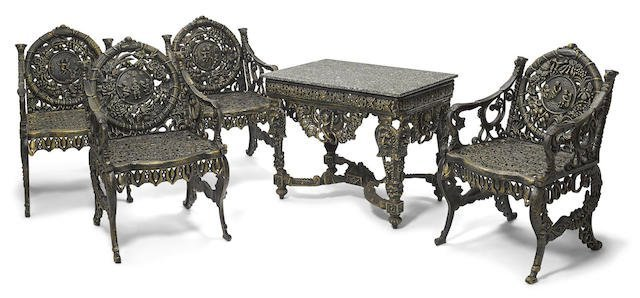 A cast iron suite of garden furniture Cast iron garden furniture