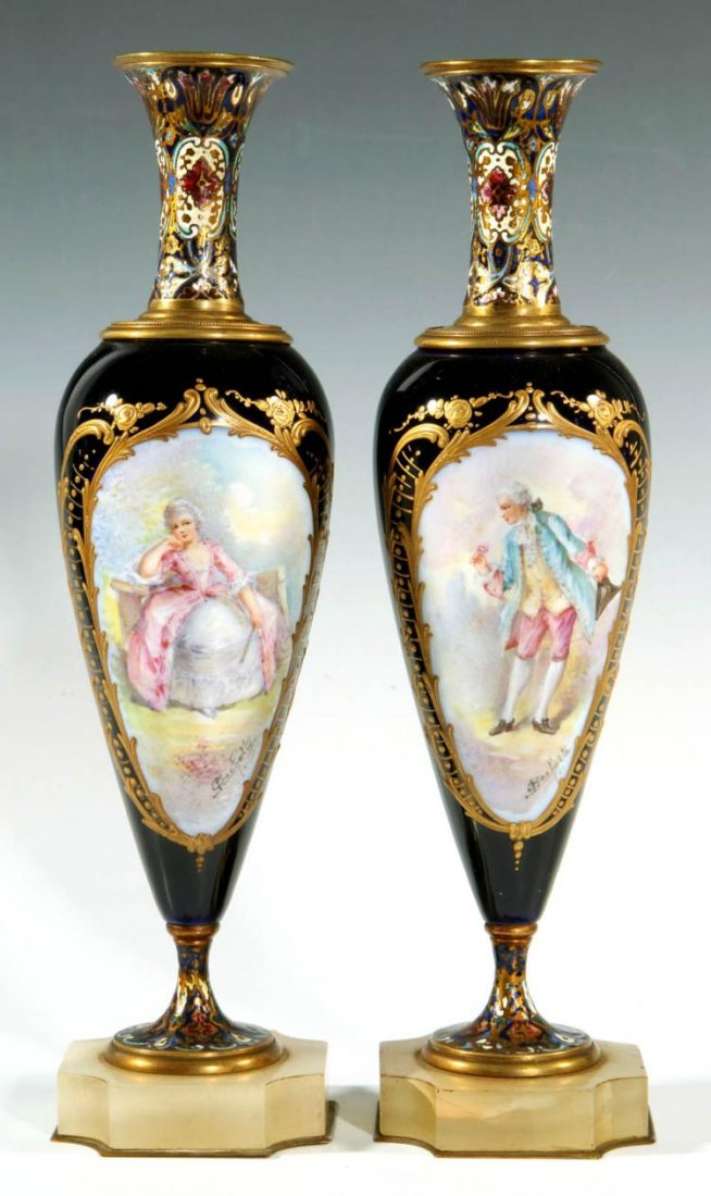 Pair of Sevres Porcelain Vases with Chmapleve Enamel Edit