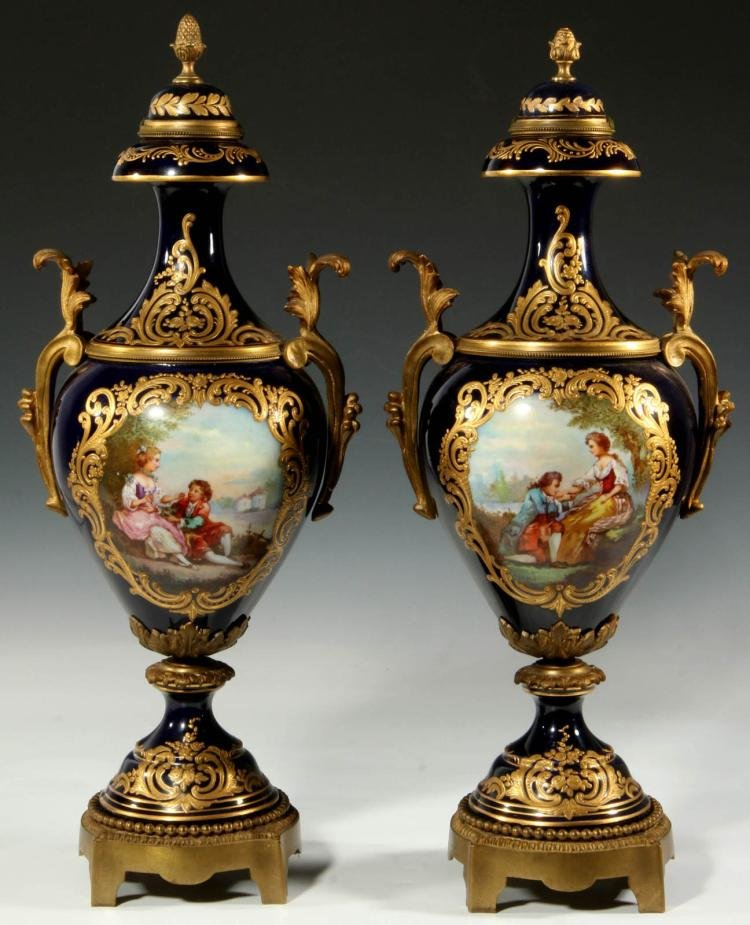 Pair of 19th C. Bronze Mounted Sevres Porcelain Urns Edit