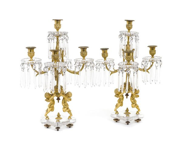 A PAIR OF BACCARAT GILT BRONZE CRYSTAL CANDELABRA