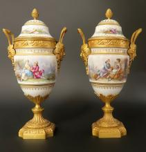 Pair of French Bronze & Sevres Porcelain Urns. 19th Century.