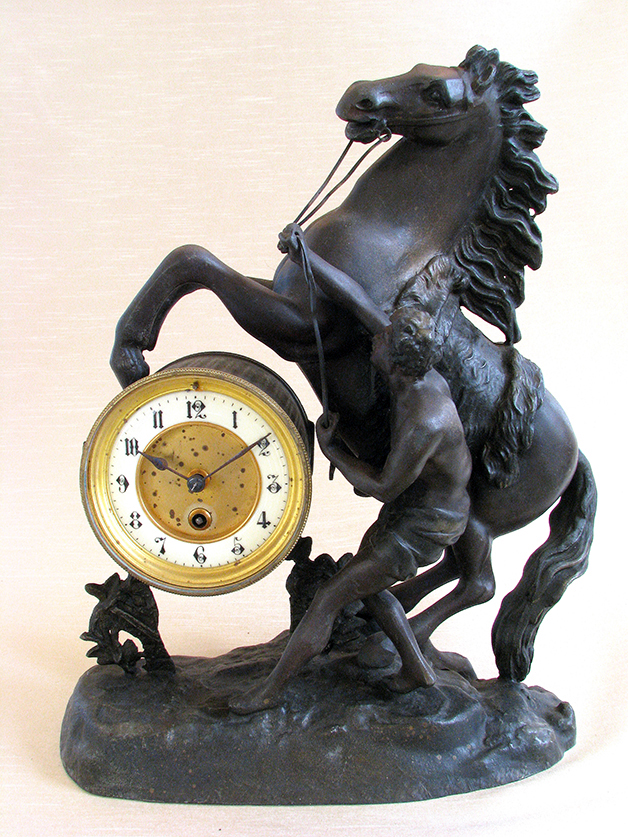 A French Patinated Metal Figural Mantel Clock