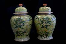 A large pair of rare green glazed vases