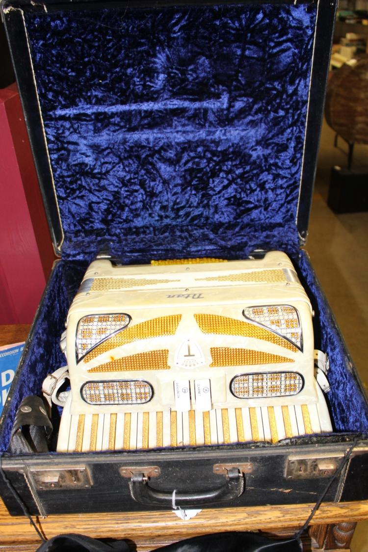 Titan Accordion, product of Titano made in Italy in case
