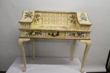 Off white and gold oriental desk with lovely floral patterns