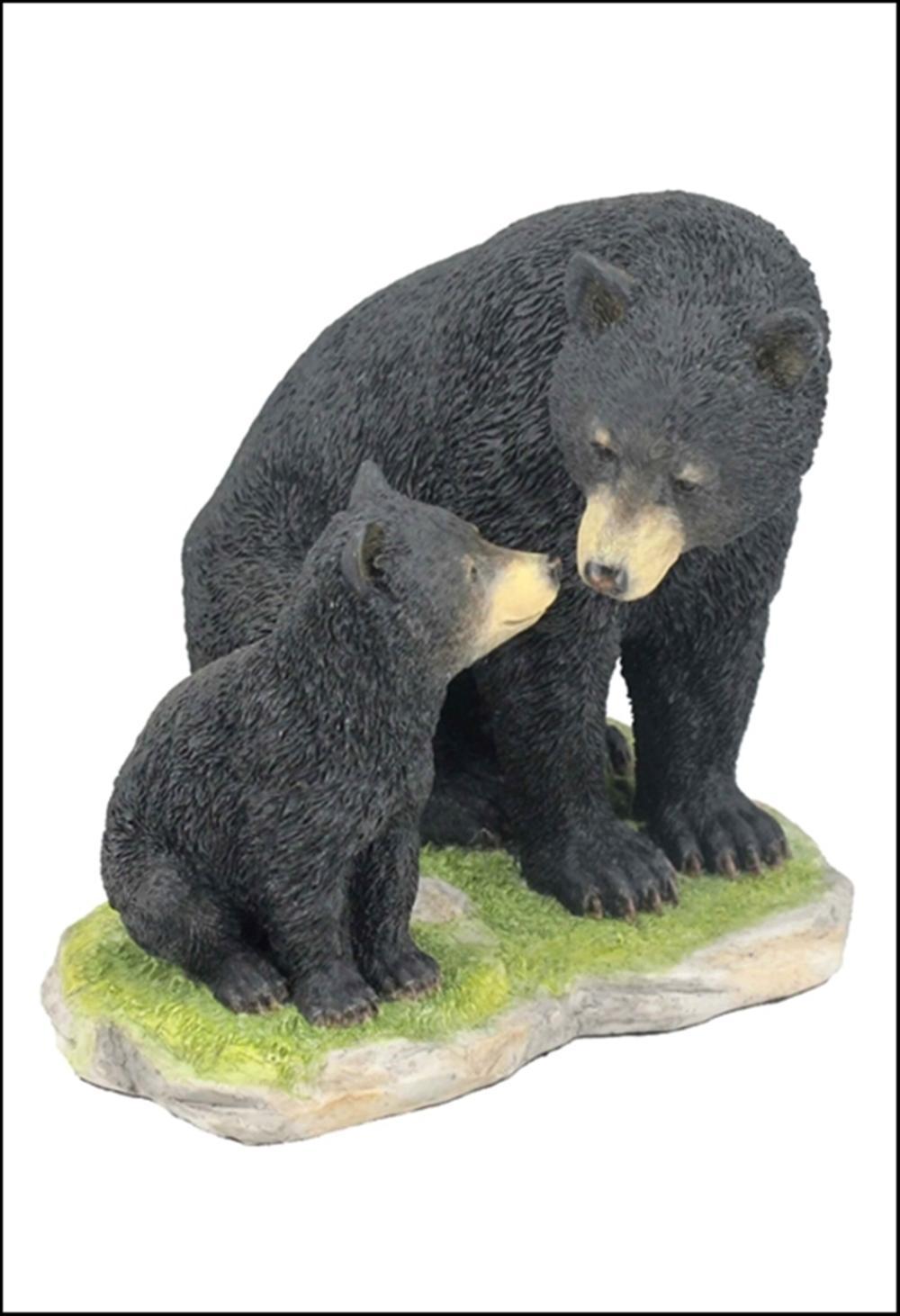 BLACK BEAR SITTING WITH HER CUB