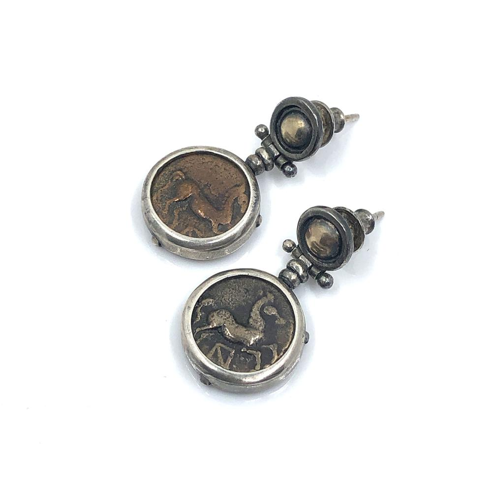 Lot 311: A pair of Thracian bronze coins set as earrings, ca  400 - 380 BC