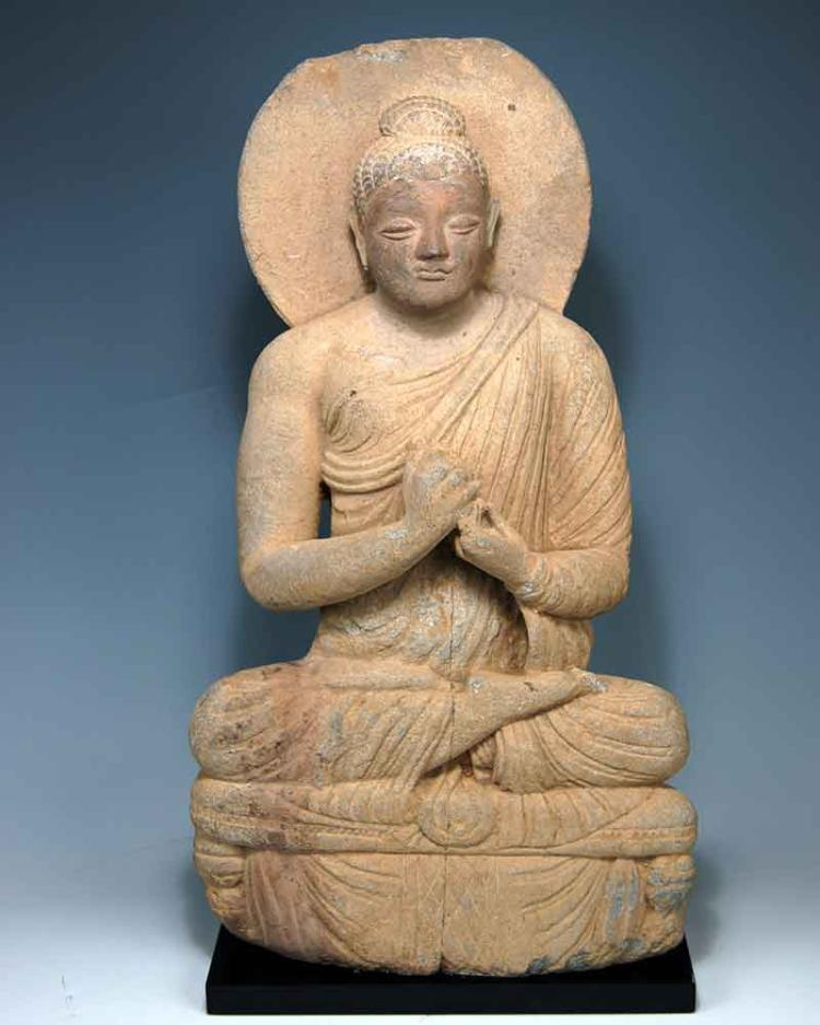 A large Grey Schist Seated Buddha, Gandhara, Peshawar Valley, ca. 3rd century A.D.