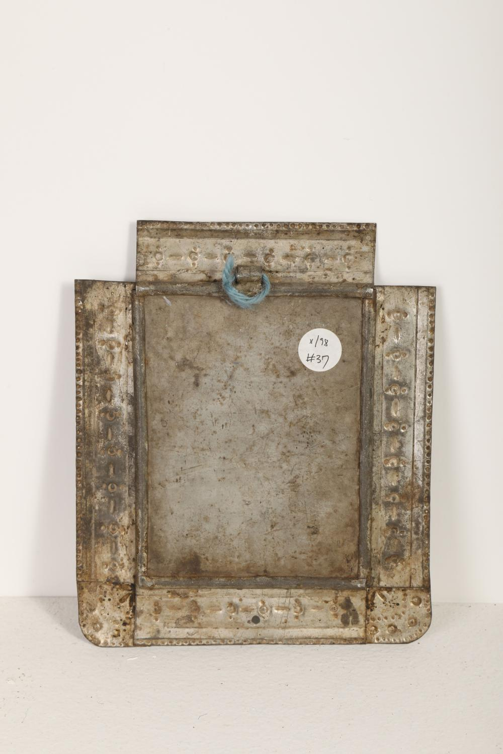 A Pair of Tin Frames with Devotional Prints