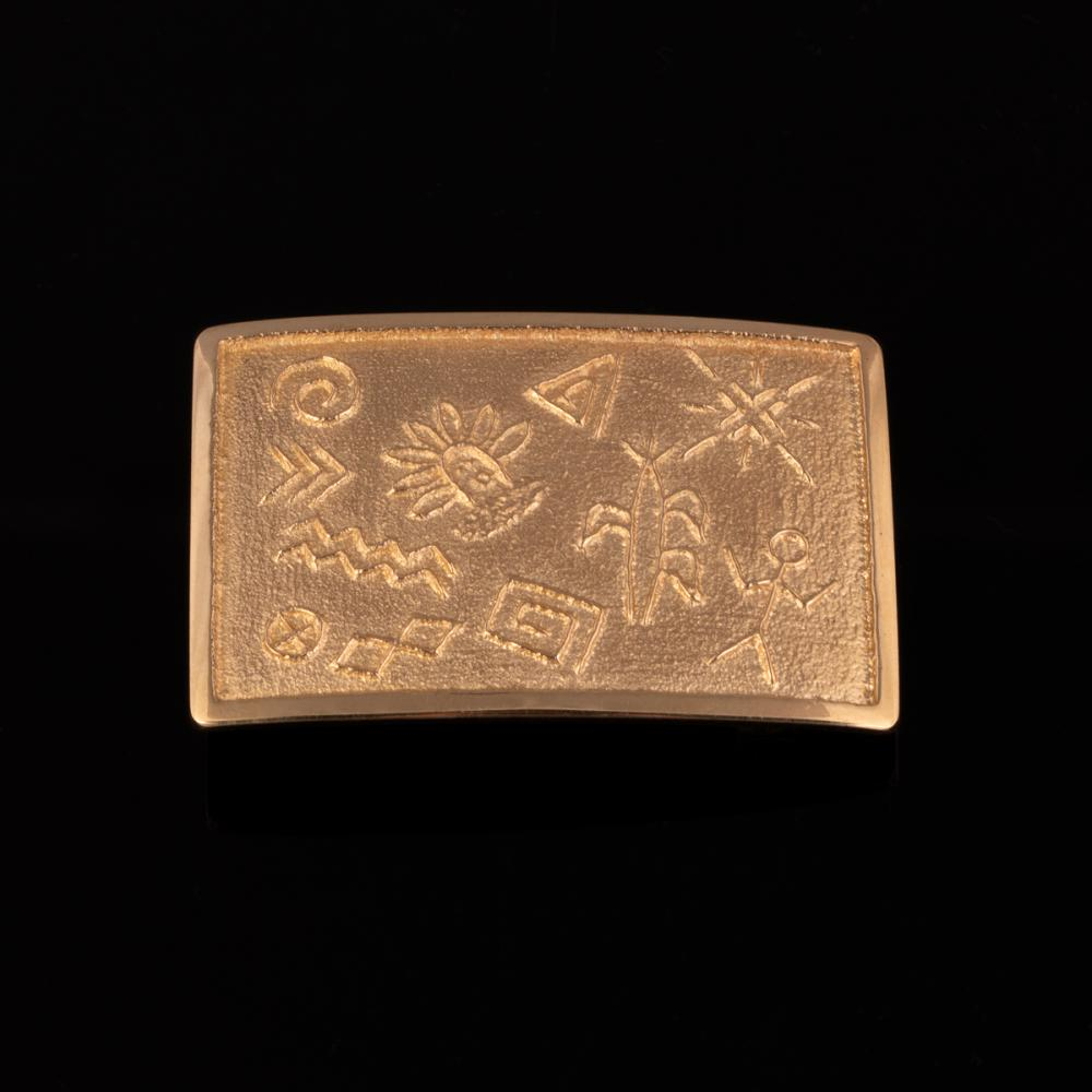 A Harvey Begay Yellow Gold Tufa Cast Pictorial Belt Buckle
