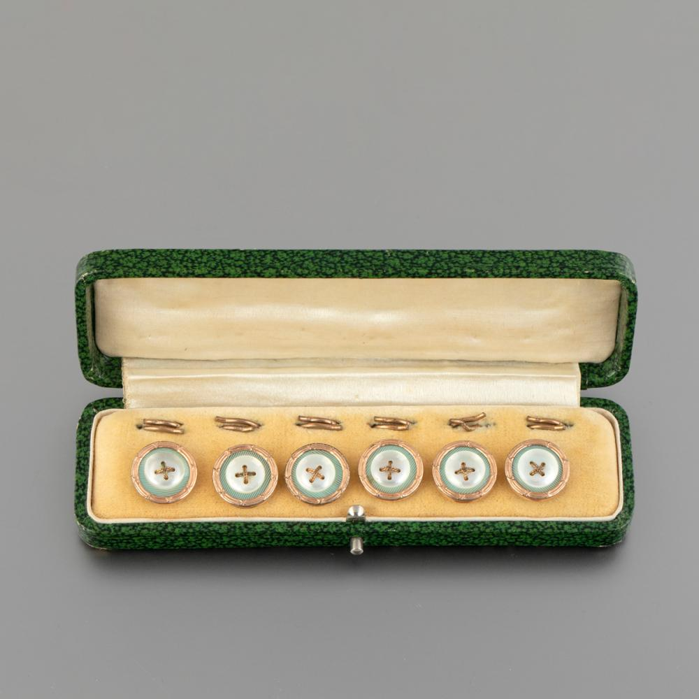 A Set of French Gilt Brass and Pink Gold Studs