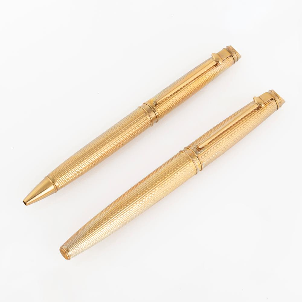 A Pair of Limited Edition Caran d'Ache Gold Plated Pens