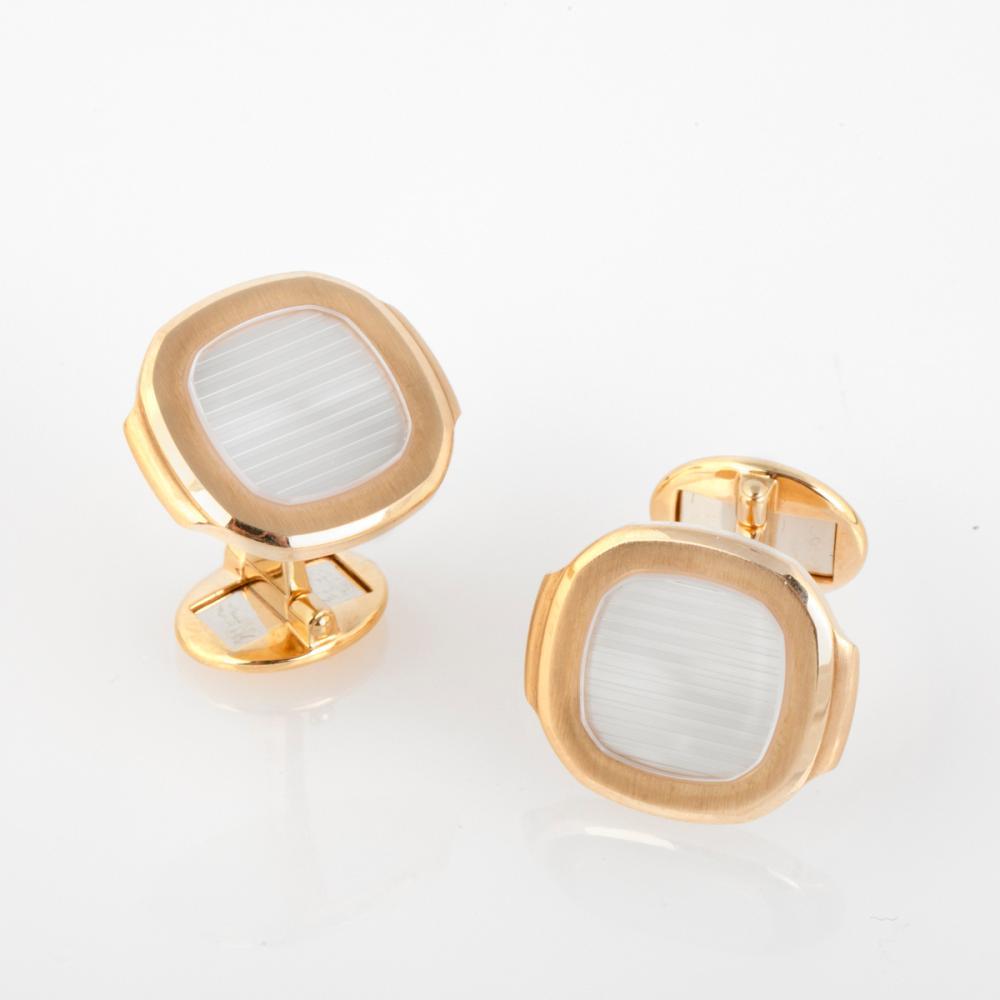 A Pair of Patek Philippe Nautilus Gold Cufflinks